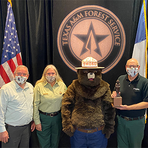 Employees at Texas A&M Forest Service have been awarded two Bronze Smokey Bear Awards for their wildfire prevention outreach efforts across the nation over the course of Smokey Bear's 75th Birthday in 2019.