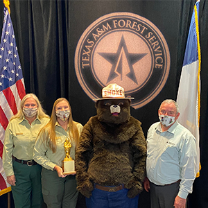 Karen Stafford, Wildfire Prevention Program Coordinator with Texas A&M Forest Service is one of the members on a national team that has earned the Gold Smokey Bear Award.