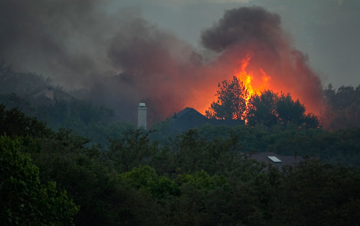 HOMES BUILT IN DENSE VEGETATION WITH WILDFIRE QUICKLY APPROACHING