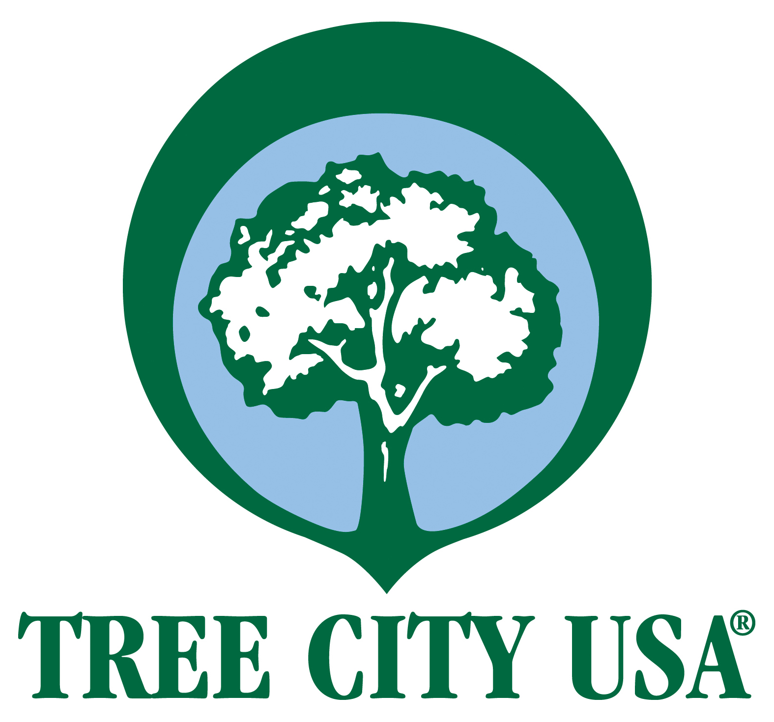 LOGO FOR TREE CITY USA PROGRAM.  GREEN AND BLUE CONCENTRIC CIRCLES WITH A GREEN OUTLINE OF A TREE INSIDE